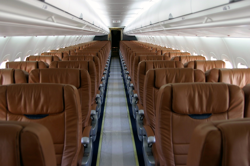 A Photo Of Boeing 717 200 First Class Cabin Or Section