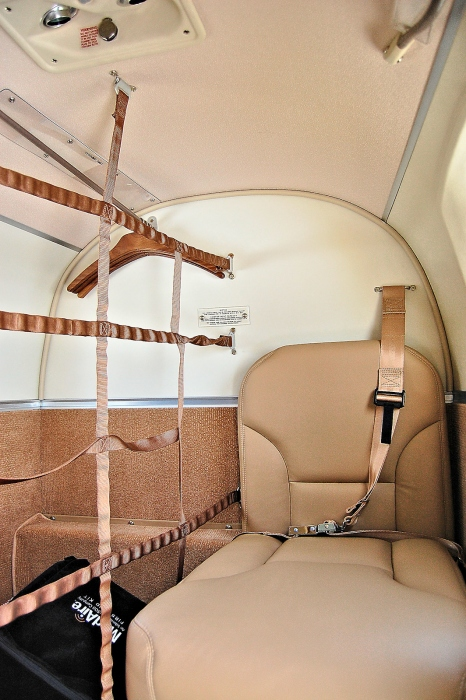A photo of the Beechcraft King Air C90GTx cabin with the rear seat and cargo or baggage area