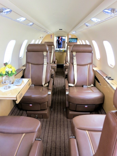 Bombardier Learjet 45 XR Interior Cabin photo with brown seats and carpets