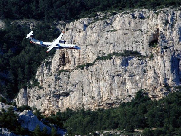 Bombardier Q400 MR Airtanker Flying Around Mountians Photo