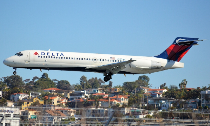 A photo of a Delta Air Lines Boeing 717-200 jet landing in San Diego